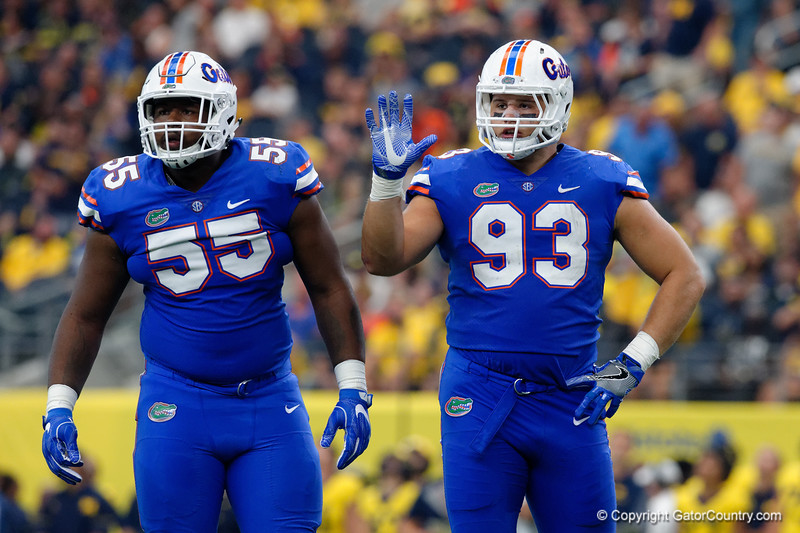University of Florida Gators defensive lineman Kyree Campbell and University of Florida Gators defensive lineman Taven Bryan during the first half of the 2017 Advocare Classic at AT&T Stadium in Dallas, Texas as the Florida Gators take on the Michigan Wolverines. September 2nd, 2017.  Gator Country photo by David Bowie.