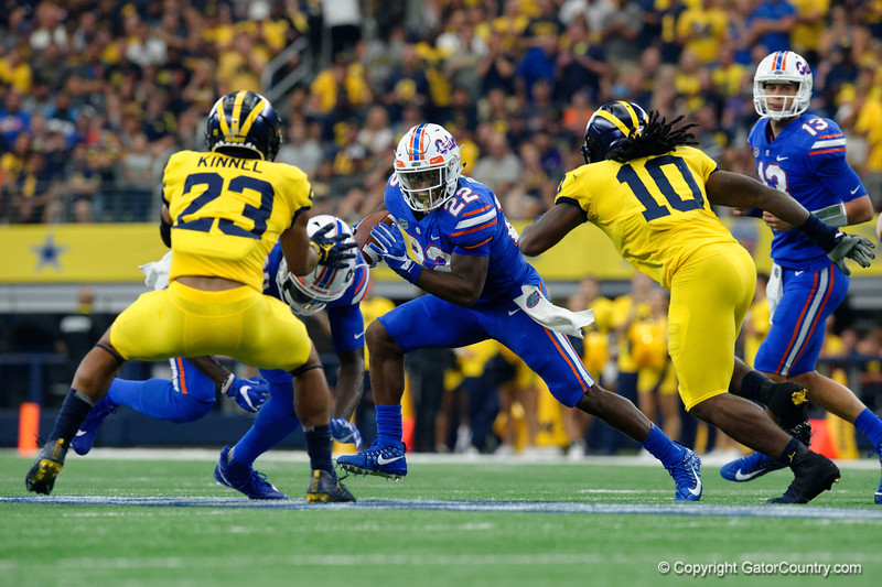 University of Florida Gators running back Lamical Perine rushing during the first half of the 2017 Advocare Classic at AT&T Stadium in Dallas, Texas as the Florida Gators take on the Michigan Wolverines. September 2nd, 2017.  Gator Country photo by David Bowie.