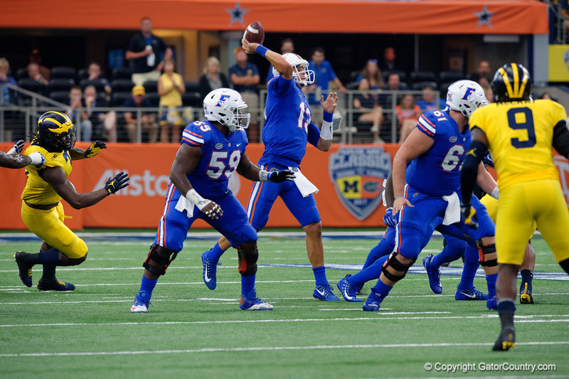 University of Florida Gators quarterback Feleipe Franks throwing during the first half of the 2017 Advocare Classic at AT&T Stadium in Dallas, Texas as the Florida Gators take on the Michigan Wolverines. September 2nd, 2017.  Gator Country photo by David Bowie.
