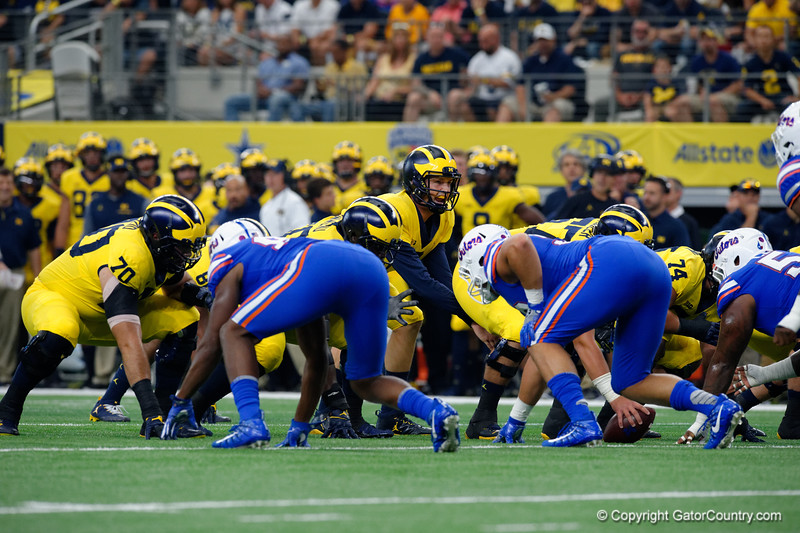 Michigan quarterback Wilton Speight lining up under center during the first half of the 2017 Advocare Classic at AT&T Stadium in Dallas, Texas as the Florida Gators take on the Michigan Wolverines. September 2nd, 2017.  Gator Country photo by David Bowie.