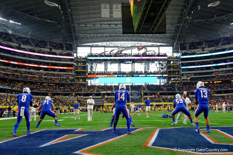 University of Florida Gators quarterbacks Malik Zaire, Felipe Franks and Luke Del Rio throwing during pre-gamef of the 2017 Advocare Classic at AT&T Stadium in Dallas, Texas as the Florida Gators take on the Michigan Wolverines. September 2nd, 2017.  Gator Country photo by David Bowie.