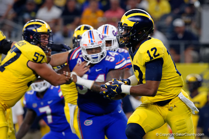 Michigan running back Chris Evans rushing during the first half of the 2017 Advocare Classic at AT&T Stadium in Dallas, Texas as the Florida Gators take on the Michigan Wolverines. September 2nd, 2017.  Gator Country photo by David Bowie.