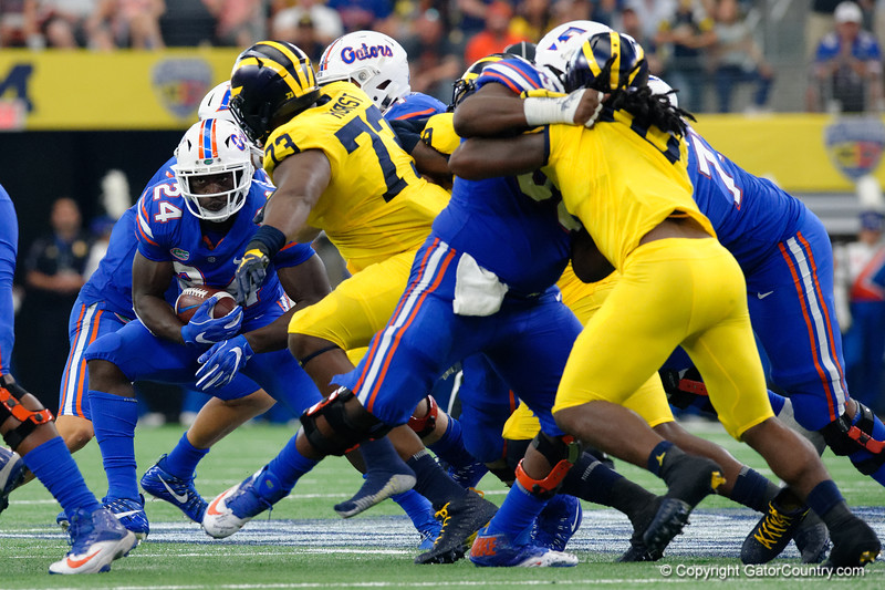 University of Florida Gators running back Mark Thompson rushing during the first half of the 2017 Advocare Classic at AT&T Stadium in Dallas, Texas as the Florida Gators take on the Michigan Wolverines. September 2nd, 2017.  Gator Country photo by David Bowie.