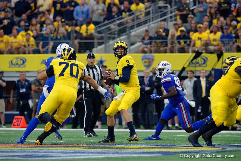 Michigan quarterback Wilton Speight throwing during the first half of the 2017 Advocare Classic at AT&T Stadium in Dallas, Texas as the Florida Gators take on the Michigan Wolverines. September 2nd, 2017.  Gator Country photo by David Bowie.