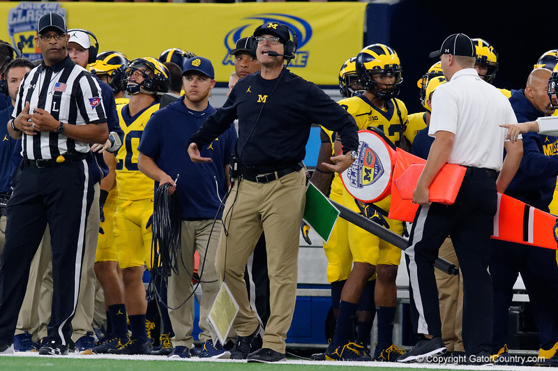 Michigan head coach John Harbaugh watching on from the sideline during the first half of the 2017 Advocare Classic at AT&T Stadium in Dallas, Texas as the Florida Gators take on the Michigan Wolverines. September 2nd, 2017.  Gator Country photo by David Bowie.
