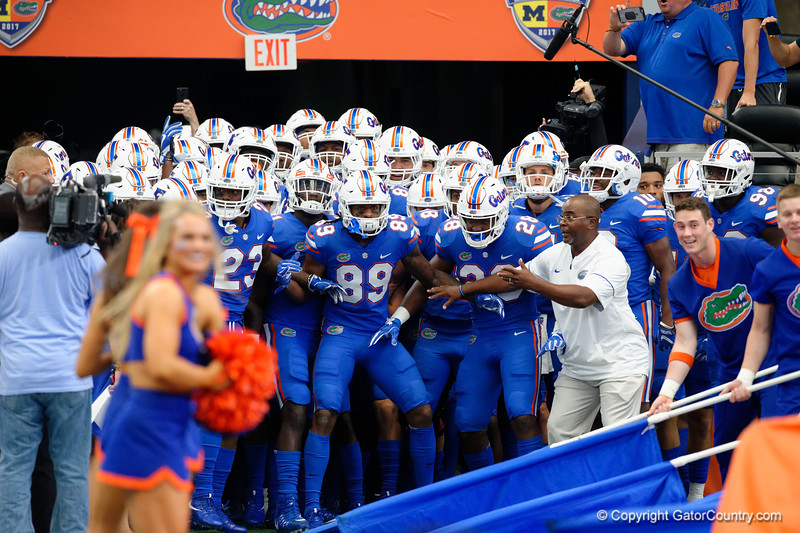 The Florida Gators take the field during pre-gamef of the 2017 Advocare Classic at AT&T Stadium in Dallas, Texas as the Florida Gators take on the Michigan Wolverines. September 2nd, 2017.  Gator Country photo by David Bowie.