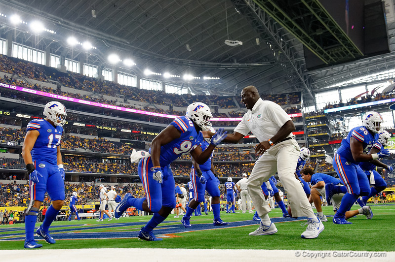 University of Florida Gators defensive end Antonneous Clayton and University of Florida Gators defensive line coach Chris Rumph working during pre-gamef of the 2017 Advocare Classic at AT&T Stadium in Dallas, Texas as the Florida Gators take on the Michigan Wolverines. September 2nd, 2017.  Gator Country photo by David Bowie.