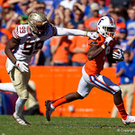 University of Florida Gators wide receiver Dre Massey tries to break free of a tackle attempt during the first half in which the Gators lost 38-22 to the Florida State Seminoles at  Ben Hill Griffin Stadium in Gainesville, Florida. November 25th, 2017.  Gator Country photo by David Bowie.