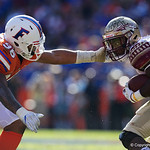 University of Florida Gators defensive lineman Cece Jefferson tries to grab a hold of Noles running back Cam Akers during the second half in which the Gators lost 38-22 to the Florida State Seminoles at  Ben Hill Griffin Stadium in Gainesville, Florida. November 25th, 2017.  Gator Country photo by David Bowie.