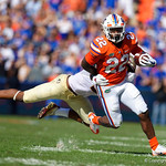 University of Florida Gators running back Lamical Perine rushing during the first half in which the Gators lost 38-22 to the Florida State Seminoles at  Ben Hill Griffin Stadium in Gainesville, Florida. November 25th, 2017.  Gator Country photo by David Bowie.