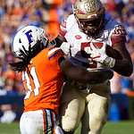 University of Florida Gators defensive back Shawn Davis makes a tackle during the second half in which the Gators lost 38-22 to the Florida State Seminoles at  Ben Hill Griffin Stadium in Gainesville, Florida. November 25th, 2017.  Gator Country photo by David Bowie.