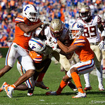 University of Florida Gators defensive back Shawn Davis and University of Florida Gators cornerback Marco Wilson combine for a tackle during the second half in which the Gators lost 38-22 to the Florida State Seminoles at  Ben Hill Griffin Stadium in Gainesville, Florida. November 25th, 2017.  Gator Country photo by David Bowie.