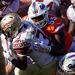 University of Florida Gators defensive lineman Kyree Campbell makes a tackle during the second half in which the Gators lost 38-22 to the Florida State Seminoles at  Ben Hill Griffin Stadium in Gainesville, Florida. November 25th, 2017.  Gator Country photo by David Bowie.