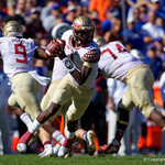 Florida State Seminoles quarterback James Blackman rolls out during the first half in which the Gators lost 38-22 to the Florida State Seminoles at  Ben Hill Griffin Stadium in Gainesville, Florida. November 25th, 2017.  Gator Country photo by David Bowie.