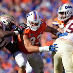 University of Florida Gators defensive lineman Taven Bryan tries to break free of a block during the second half in which the Gators lost 38-22 to the Florida State Seminoles at  Ben Hill Griffin Stadium in Gainesville, Florida. November 25th, 2017.  Gator Country photo by David Bowie.