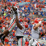 Georgia Bulldgos offensive lineman Isaiah Wynn lifts running back Nick Chubb into the air after Chubb rushed to put the Bulldogs up 7-0 during the first half as the Gators lose to 42-7 to the Georgia Bulldogs at EverBank Field in Jacksonville, Florida.  October 28th, 2017.  Gator Country photo by David Bowie.