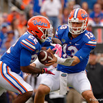 University of Florida Gators quarterback Feleipe Franks turns and hands the ball of to University of Florida Gators running back Lamical Perine during the first half as the Gators lose to 42-7 to the Georgia Bulldogs at EverBank Field in Jacksonville, Florida.  October 28th, 2017.  Gator Country photo by David Bowie.