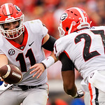 Georgia Bulldogs quarterback Jake Fromm turns to hand the ball off to Nick Chubb during the second half as the Gators lose to 42-7 to the Georgia Bulldogs at EverBank Field in Jacksonville, Florida.  October 28th, 2017.  Gator Country photo by David Bowie.