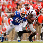 University of Florida Gators linebacker Jeremiah Moon attempting to tackle Georgia wide receiver Mecole Hardman during the first half as the Gators lose to 42-7 to the Georgia Bulldogs at EverBank Field in Jacksonville, Florida.  October 28th, 2017.  Gator Country photo by David Bowie.