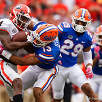Georgia wide receiver Mecole Hardman is tackled by University of Florida Gators safety Donovan Stiner during the first half as the Gators lose to 42-7 to the Georgia Bulldogs at EverBank Field in Jacksonville, Florida.  October 28th, 2017.  Gator Country photo by David Bowie.