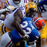 University of Florida Gators running back Lamical Perine is tackled by LSU Tigers Devin White during the first half as the Florida Gators lose on homecoming to the  LSU Tigers 17-16 at Ben Hill Griffin Stadium in Gainesville, Florida. October 7th, 2017.  Gator Country photo by David Bowie.