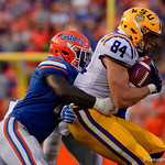 LSU tight end Foster Moreau makes a catch and is tackled by University of Florida Gators linebacker Vosean Joseph during the second half as the Florida Gators lose on homecoming to the  LSU Tigers 17-16 at Ben Hill Griffin Stadium in Gainesville, Florida. October 7th, 2017.  Gator Country photo by David Bowie.