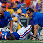 Florida trainers check on University of Florida Gators defensive back Chauncey Gardner, Jr. during the first half as the Florida Gators lose on homecoming to the  LSU Tigers 17-16 at Ben Hill Griffin Stadium in Gainesville, Florida. October 7th, 2017.  Gator Country photo by David Bowie.
