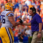 LSU head coach Ed Orgeron congratulates his players during the first half as the Florida Gators lose on homecoming to the  LSU Tigers 17-16 at Ben Hill Griffin Stadium in Gainesville, Florida. October 7th, 2017.  Gator Country photo by David Bowie.