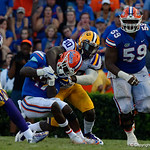 University of Florida Gators athlete Kadarius Toney is tackled by LSU linebacker Devin White during the second half as the Florida Gators lose on homecoming to the  LSU Tigers 17-16 at Ben Hill Griffin Stadium in Gainesville, Florida. October 7th, 2017.  Gator Country photo by David Bowie.