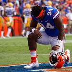 University of Florida Gators defensive end Zachary Carter prays in the endzone prior to kickoff during pregame as the Florida Gators lose on homecoming to the  LSU Tigers 17-16 at Ben Hill Griffin Stadium in Gainesville, Florida. October 7th, 2017.  Gator Country photo by David Bowie.
