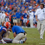 University of Florida Gators head coach Jim McElwain comes out to check on an injured University of Florida Gators linebacker Jeremiah Moon during the second half as the Florida Gators lose on homecoming to the  LSU Tigers 17-16 at Ben Hill Griffin Stadium in Gainesville, Florida. October 7th, 2017.  Gator Country photo by David Bowie.