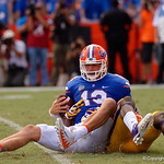 University of Florida Gators quarterback Feleipe Franks sacked by LSU linebacker Devin White during the first half as the Florida Gators lose on homecoming to the  LSU Tigers 17-16 at Ben Hill Griffin Stadium in Gainesville, Florida. October 7th, 2017.  Gator Country photo by David Bowie.