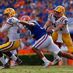 LSU Quarterback Danny Etling is sacked by University of Florida Gators defensive lineman Jabari Zuniga during the first half as the Florida Gators lose on homecoming to the  LSU Tigers 17-16 at Ben Hill Griffin Stadium in Gainesville, Florida. October 7th, 2017.  Gator Country photo by David Bowie.