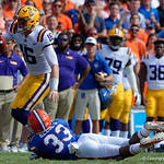 LSU Quarterback Danny Etling is tackled by University of Florida Gators linebacker David Reese during the first half as the Florida Gators lose on homecoming to the  LSU Tigers 17-16 at Ben Hill Griffin Stadium in Gainesville, Florida. October 7th, 2017.  Gator Country photo by David Bowie.