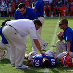 University of Florida Gators head coach Jim McElwain comes out to check on University of Florida Gators defensive back Garrett Stephens during the first half as the Florida Gators lose on homecoming to the  LSU Tigers 17-16 at Ben Hill Griffin Stadium in Gainesville, Florida. October 7th, 2017.  Gator Country photo by David Bowie.