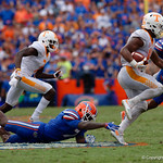 University of Florida Gators defensive back Duke Dawson dives in a attempt to tackle Tennessee Volunteers running back John Kelly during the second half as the Florida Gators defeat tne Tennessee Volunteers 26-20 at Ben Hill Griffin Stadium in Gainesville, Florida. September 16th, 2017.  Gator Country photo by David Bowie.