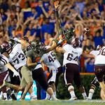 University of Florida Gators linebacker Kylan Johnson leaps into the air to try to block a kcik during the second haf as the Florida Gators drop to 3-3 on the season with a loss to tne Texas A&M Aggies 19-17 at Ben Hill Griffin Stadium in Gainesville, Florida. October 14th, 2017.  Gator Country photo by David Bowie.