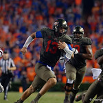 University of Florida Gators quarterback Feleipe Franks scrambling during the second half as the Florida Gators drop to 3-3 on the season with a loss to tne Texas A&M Aggies 19-17 at Ben Hill Griffin Stadium in Gainesville, Florida. October 14th, 2017.  Gator Country photo by David Bowie.