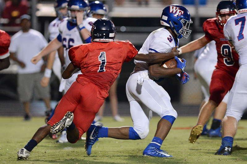Southern Nash Kevin Terrell (1) and Wake Forest Devon Lawrence (3) during tonights game.Wake Forest defeats Southern Nash 35-0, Friday evening September 15, 2017 (Photos by Anthony Barham / WRAL contributor.)