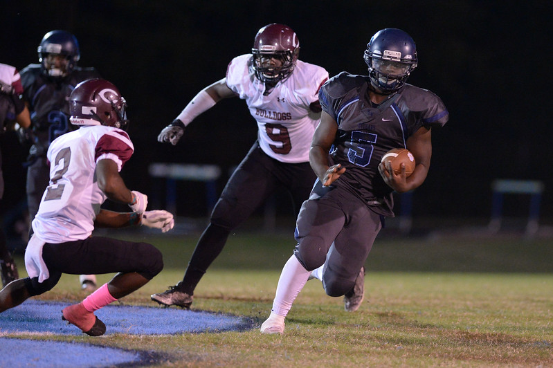 Southwest Edgecombe Alex Foster (5) and Nash Central Alex Nobles (9) during tonight's game.Southwest Edgecombe defeats Nash Central 24-14, Friday evening October 13, 2017 (Photos by Anthony Barham / WRAL contributor.)