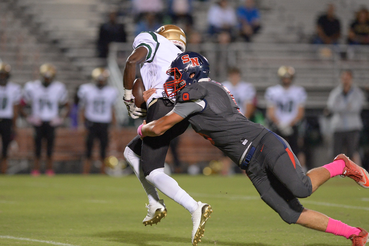 Northern Nash Trevor Sledge (6) and Southern Nash Hunter Perry (9) during tonight's game.Southern Nash defeats Northern Nash 49-0 Friday evening October13, 2017 (Photos by Anthony Barham / WRAL contributor.)