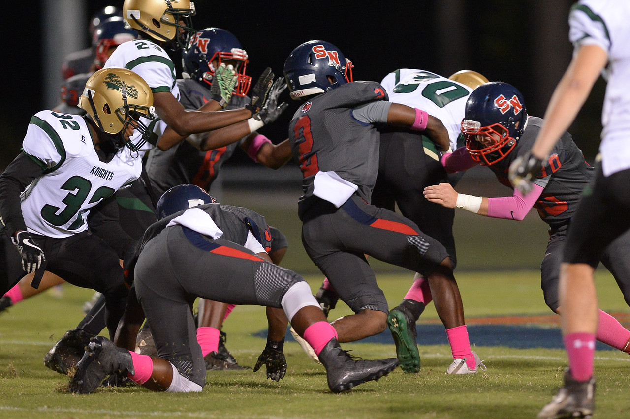 Northern Nash Tyliek Pitt (30) and Southern Nash Desmon Vick (2) during tonight's game.Southern Nash defeats Northern Nash 49-0 Friday evening October13, 2017 (Photos by Anthony Barham / WRAL contributor.)
