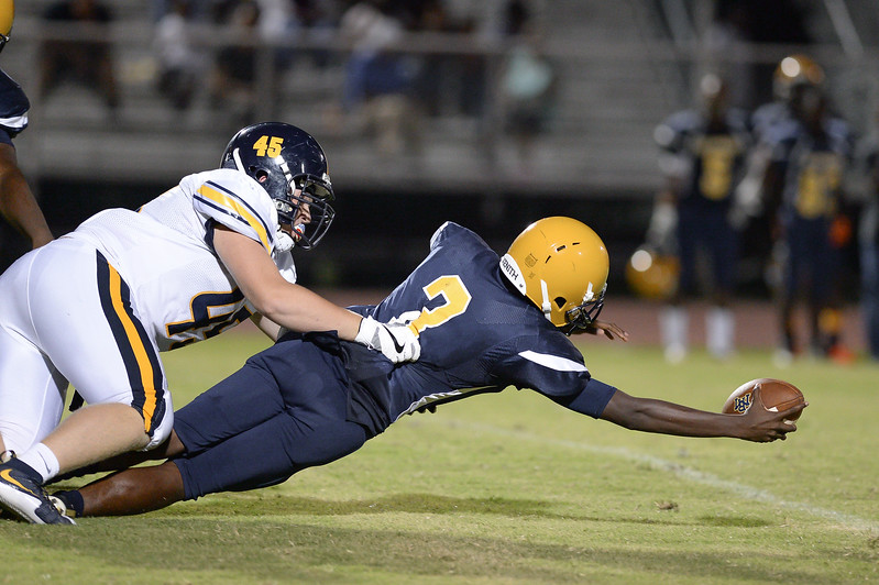 D.H. Conley Josh Dees (45) and Rocky Mount Jaquan Lynch (C) (3) during tonights game.D.H. Conley  defeats Rocky Mount 60-43, Friday evening August 25, 2017 in Rocky Mount , NC (Photos by Anthony Barham / WRAL contributor.)