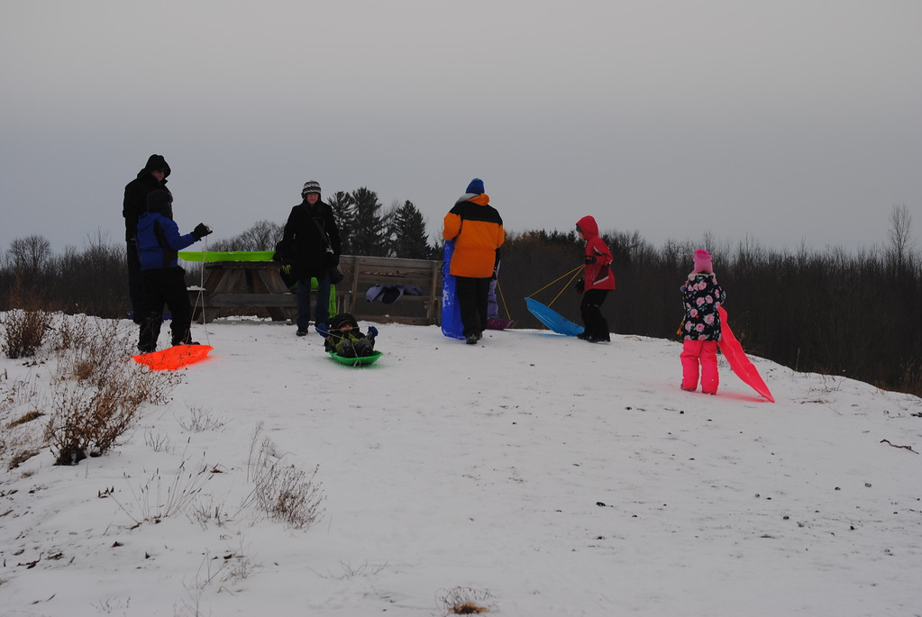 . Leah McDonald - Oneida Daily Dispatch Kids go sledding at the Winter Hibernation Festival at the Great Swamp Conservancy in Canastota, N.Y., on Saturday, Feb. 11, 2017.