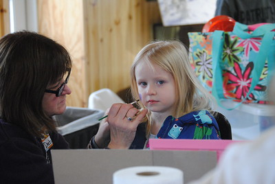 Leah McDonald - Oneida Daily Dispatch Kailin Sanderson, 5, gets her face painted at the Winter Hibernation Festival at the Great Swamp Conservancy in Canastota, N.Y., on Saturday, Feb. 11, 2017.