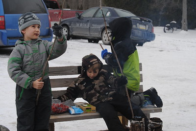 Leah McDonald - Oneida Daily Dispatch Gavin Kimball, 9, left, Damian Kimball, 4, center, and Cecil McDonald, 6, roast marshmallows at the Winter Hibernation Festival at the Great Swamp Conservancy in Canastota, N.Y., on Saturday, Feb. 11, 2017.