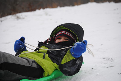 Leah McDonald - Oneida Daily Dispatch Cecil McDonald, 6, sleds down the hill at the Winter Hibernation Festival at the Great Swamp Conservancy in Canastota, N.Y., on Saturday, Feb. 11, 2017.