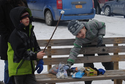 Leah McDonald - Oneida Daily Dispatch Gavin Kimball, 9, right, and Cecil McDonald, 6, roast marshmallows at the Winter Hibernation Festival at the Great Swamp Conservancy in Canastota, N.Y., on Saturday, Feb. 11, 2017.
