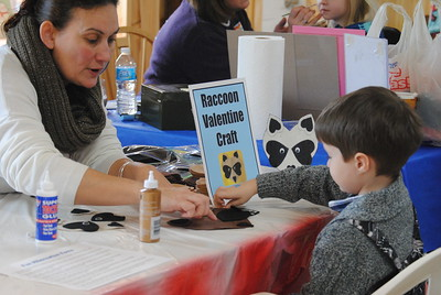 Leah McDonald - Oneida Daily Dispatch Daniel Poe Sanderson, 6, makes a raccoon Valentine at the Winter Hibernation Festival at the Great Swamp Conservancy in Canastota, N.Y., on Saturday, Feb. 11, 2017.
