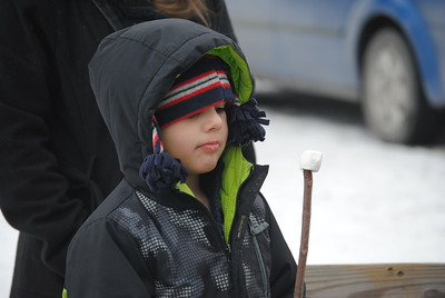 Leah McDonald - Oneida Daily Dispatch Cecil McDonald, 6, roasts marshmallows at the Winter Hibernation Festival at the Great Swamp Conservancy in Canastota, N.Y., on Saturday, Feb. 11, 2017.